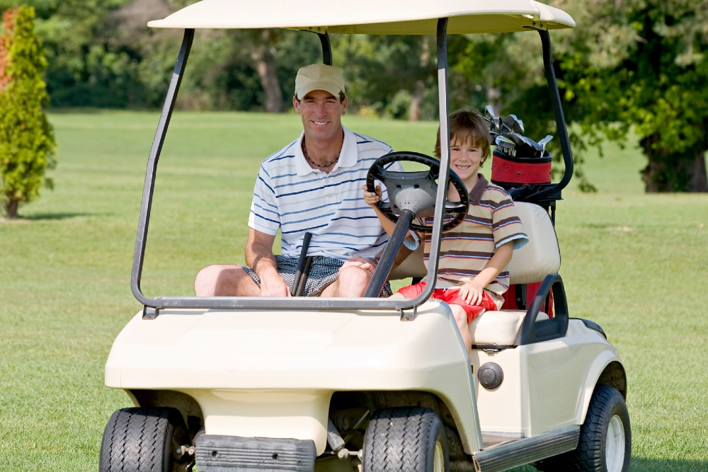 dad and son in golf court