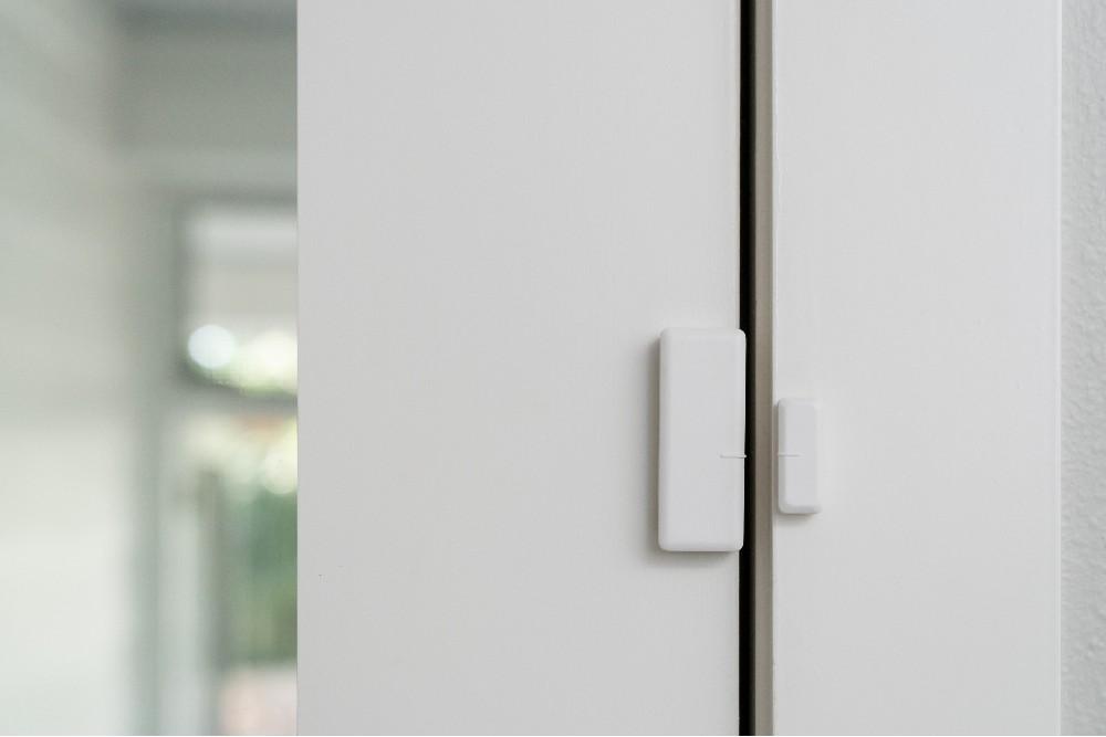 door sensor installed on clear white door
