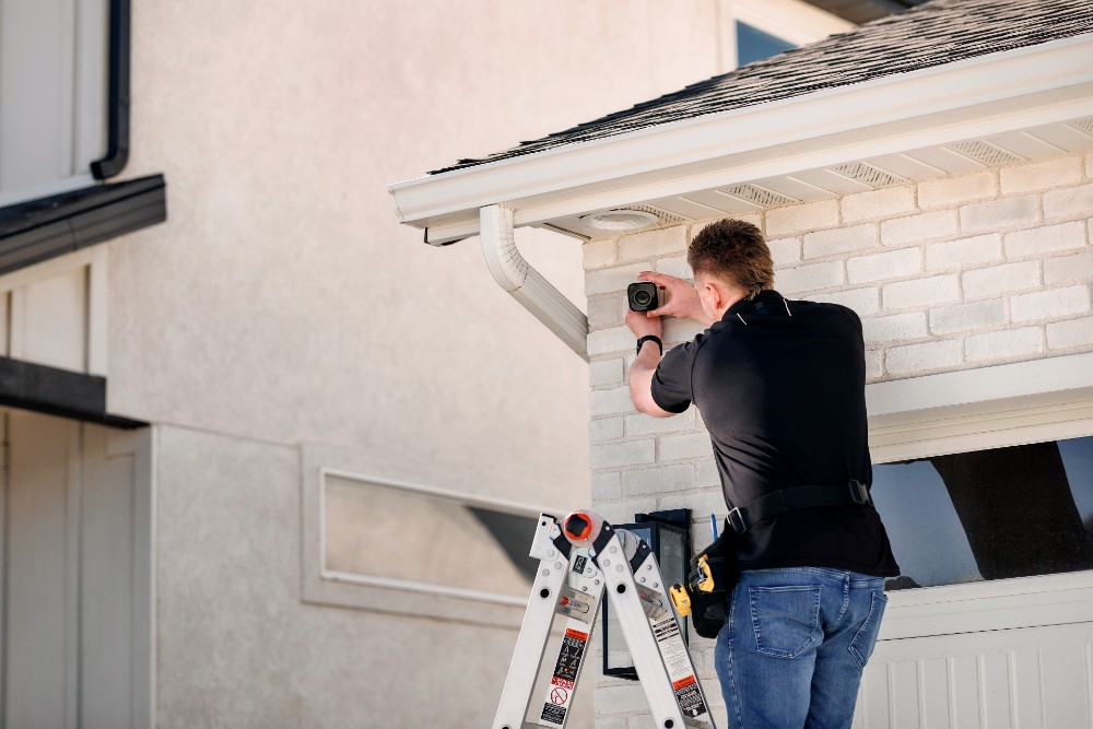 field service professional installing outdoor camera pro