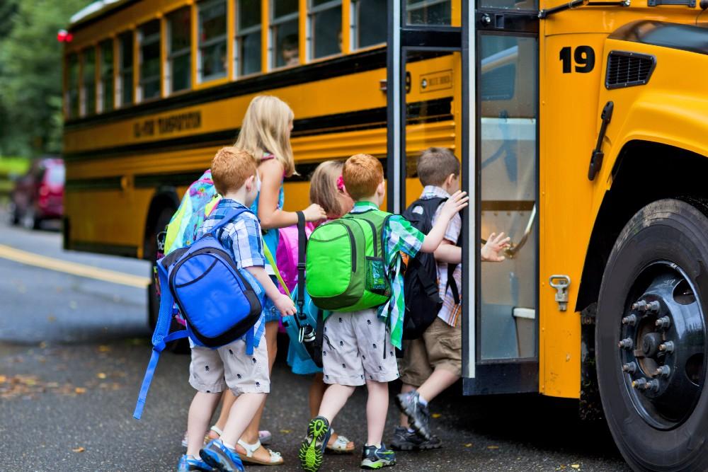 kids boarding school bus