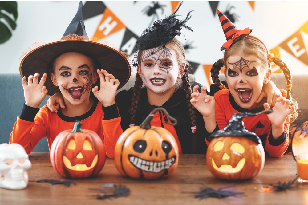 kids with face paint and painted pumpkins