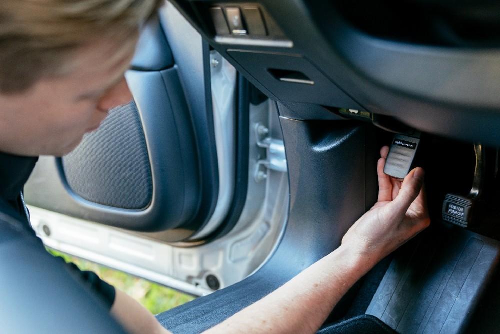 man inserting vivint car guard