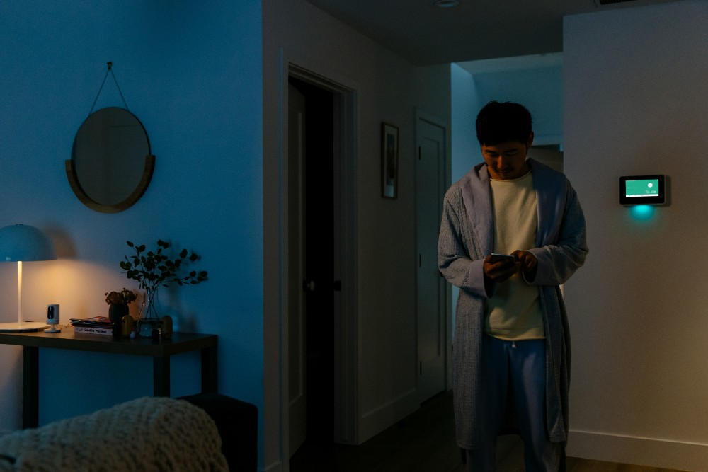 man on app with smart hub and ping in background