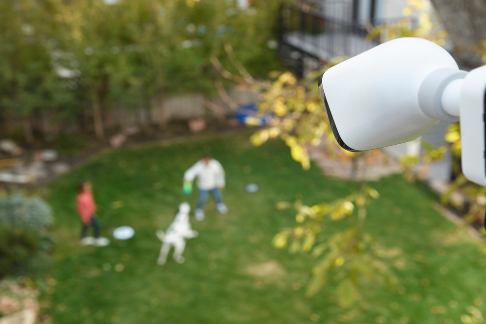 outdoor camera backyard view of family