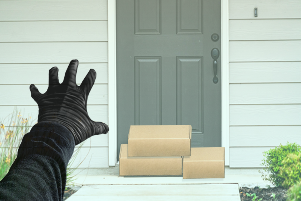 packages on front door and person with black glove reaching for them
