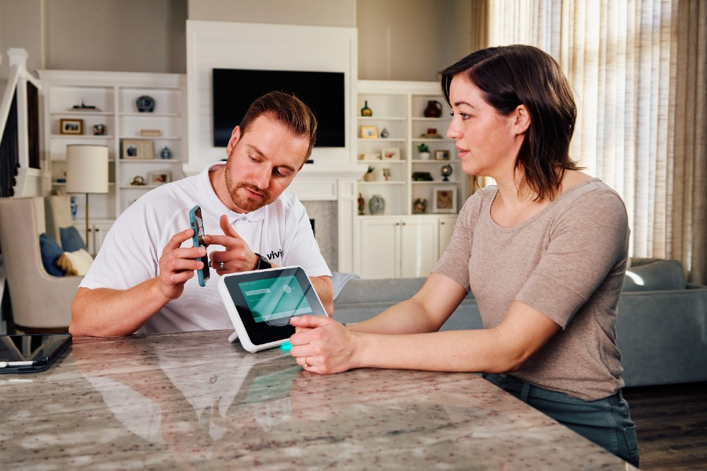 smart home pro with customer showing smart hub and app