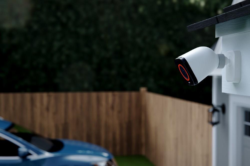 vivint outdoor camera on garage blue car