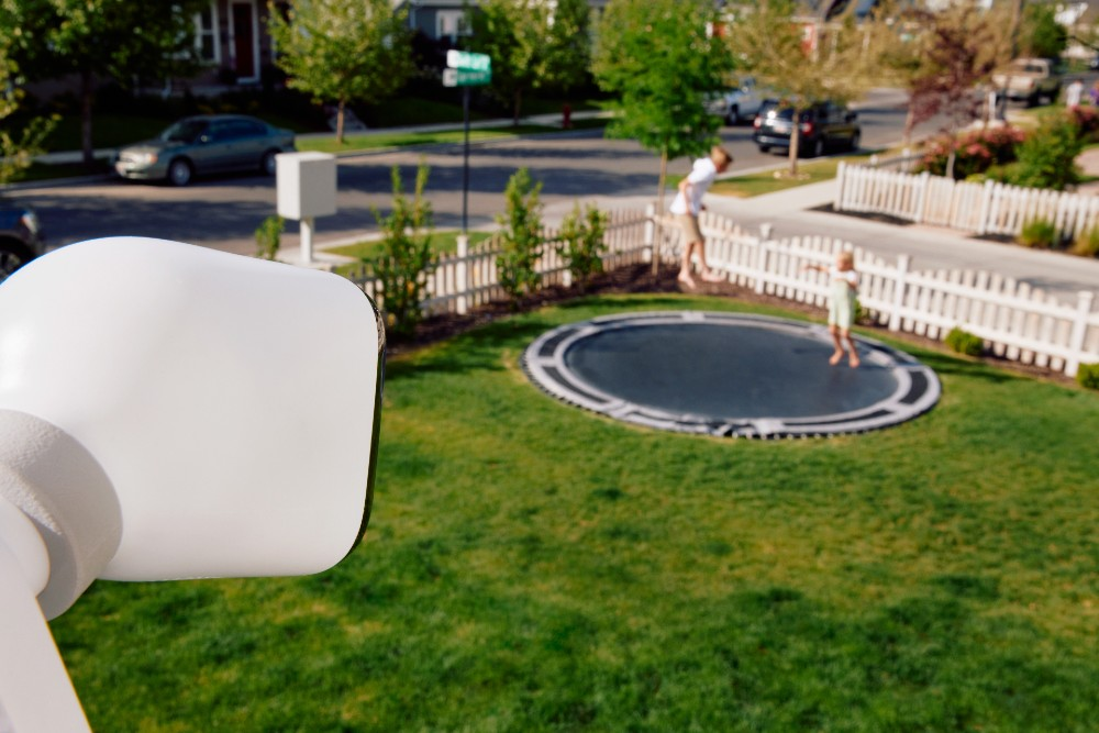 Vivint Outdoor Camera Pro with view of kids on tramp