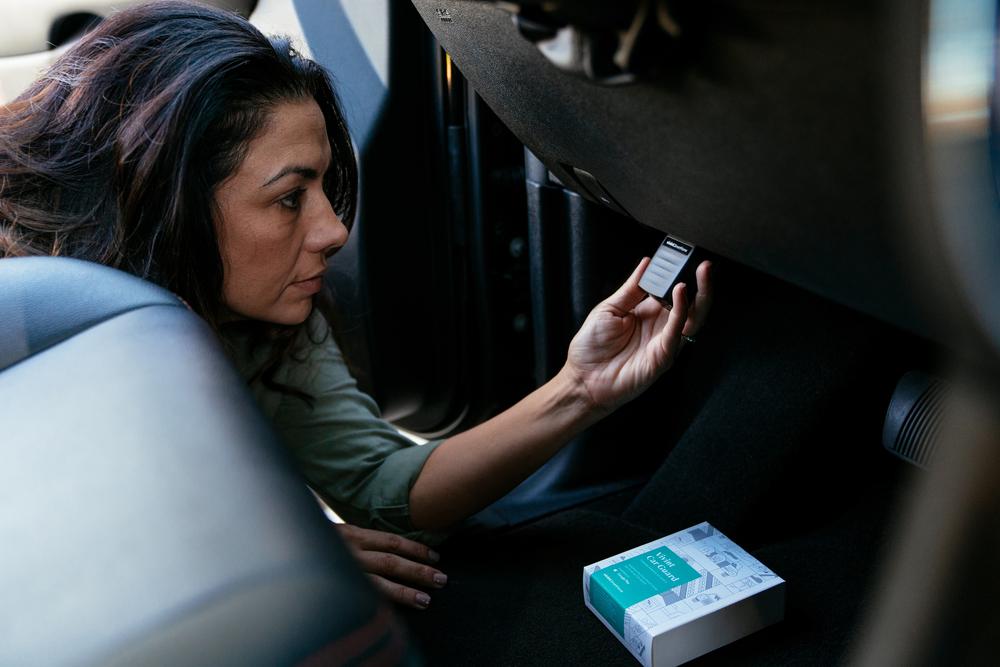 woman installing the Vivint Car Guard