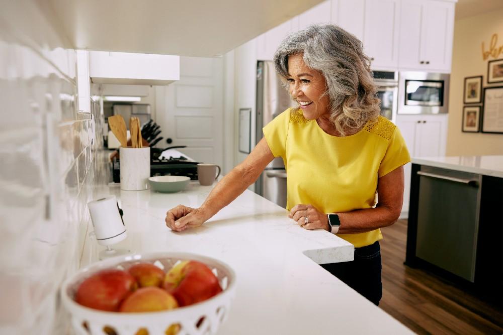 woman talking into vivint indoor camera in kitchen