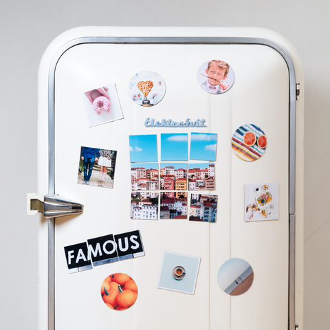 retro white refrigerator with magnets