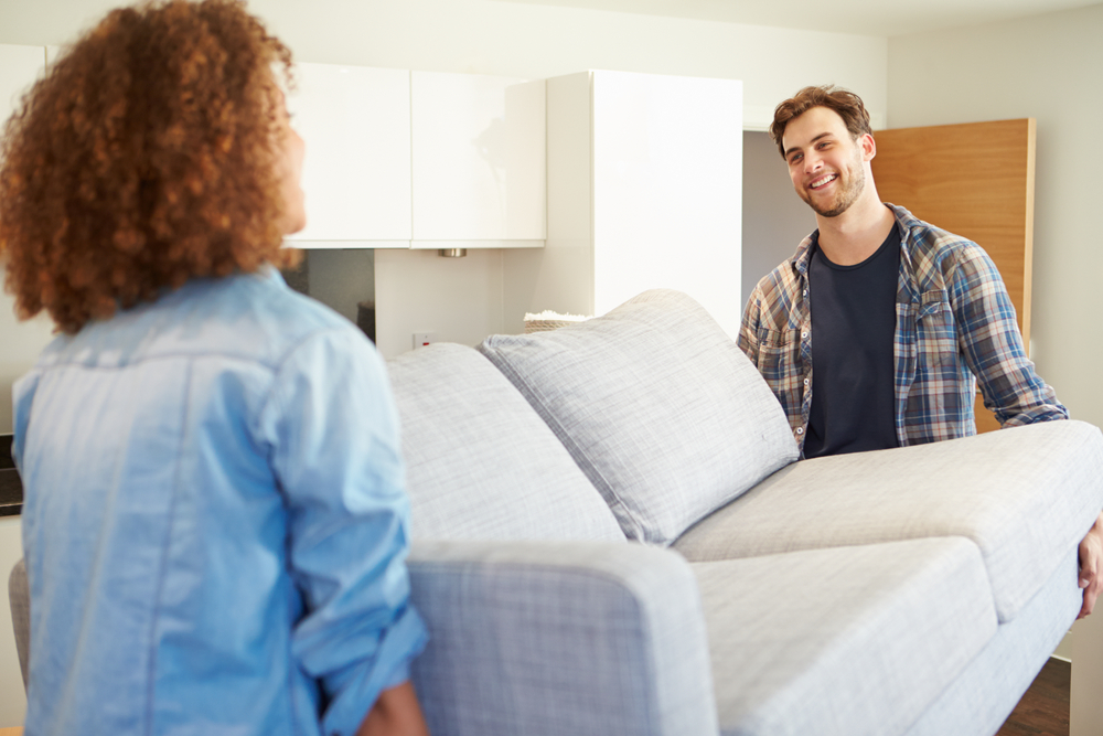 woman man moving couch