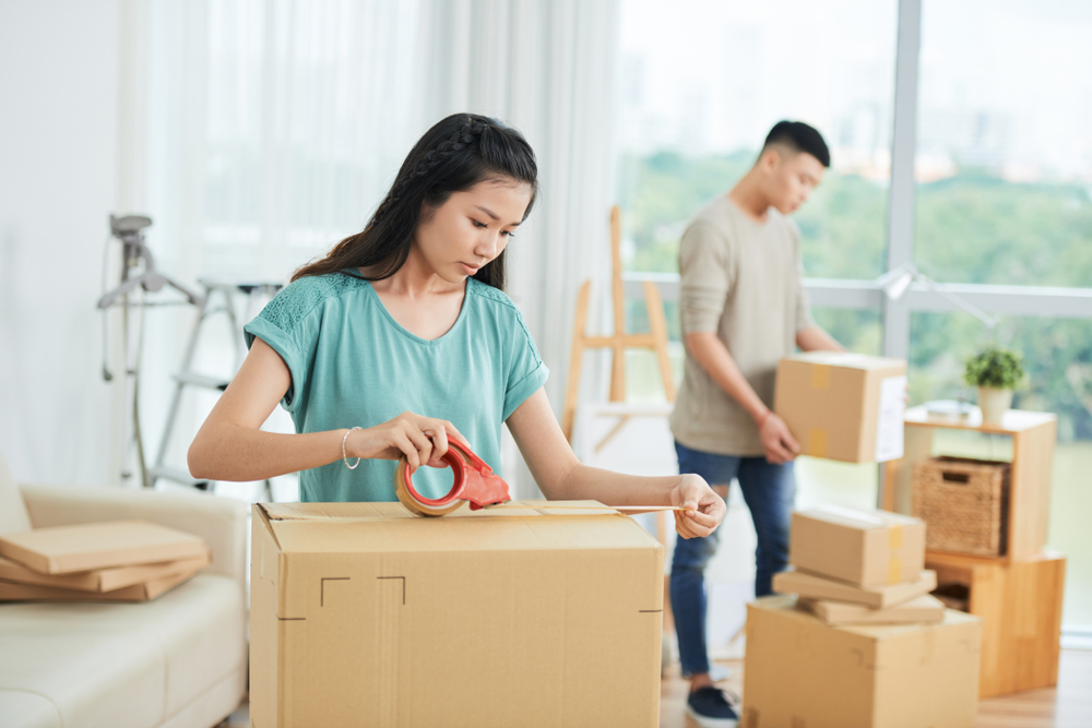 woman man packing boxes moving